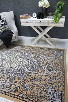 Runiullae Distressed Vintage Light Grey Beige Rug A marvelous exhibit of trendsetting rugs, this Collection instills life into extraordinary spaces. Expertly power-loomed in Turkey, these rugs are easy-care and virtually non-shedding. Classic designs become fashion-smart home decor in this alluring and playful collection.