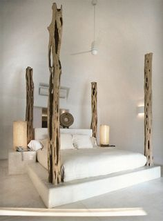 4 post bed. love this idea for the master bedroom. I would have to have a huge room to make my bed fit into it like this though...