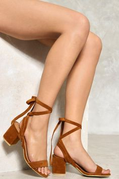 Arriving in a tan hue, these heels feature a peep-toe strap, block heel, and a double ankle strap that wraps around your ankle and into a bow. Show them off with dresses and skirts. Festival Shop, Festival Wear, Festival Outfits, Block Head, Platform Block Heels, Fringe Jacket, Strappy Sandals, Nasty Gal, Well Dressed