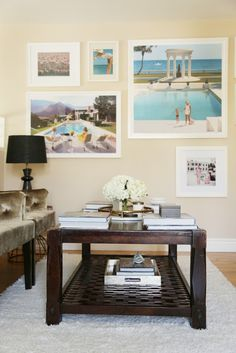 Beach gallery wall and coffee table styled with books in study