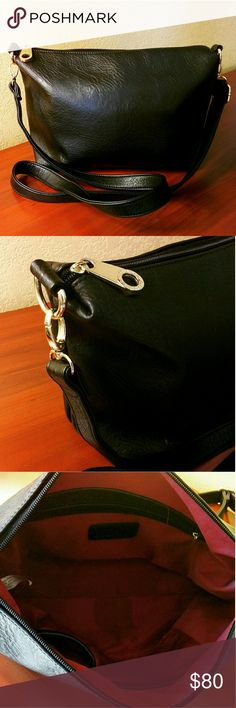 "Black Clutch Crossbody Purse Bag ⏩Made from high grade PU leather, this bag features rich black color & goldtone hardware ⏩Classy looking bag with exceptional quality! ⏩Exterior➖top zip closure,zip pocket ⏩Interior ➖1 zip pocket,2 slip pockets,lined in beautiful red wine fabric ⏩So versatile! Adjustable,detachable strap lets you convert the clutch into crossbody ⏩Great condition with the only flaws being one spot inside the bag. See last pict.  Size (apx) 15"" x 9"" 26"" max strap drop   Bags…"