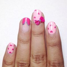 Pink heart nails with a bow by @acetonewasher
