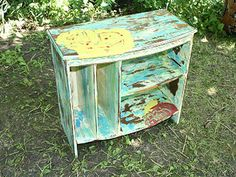 Distressing furniture with multiple layers of paint.