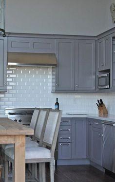 gray shaker cabinets & white beveled subway tile