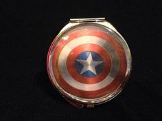 Captain America by Airship67 $15 https://www.etsy.com/listing/216397463/comic-characters-compact-mirror-your?ref=shop_home_feat_4