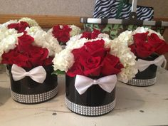 James Bond-themed short centerpieces with bow ties.