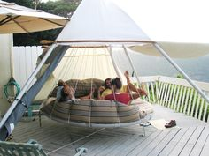 hanging lounge/bed, looks comfy- want one in my yard