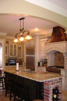Love the Mantle style stove hood and cabinets