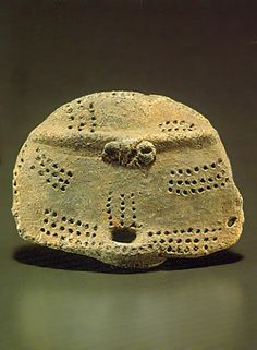 """Cross-eyed Dogu. It was exhumation only for the head.   Japanese ceramic figurine """"DOGU"""". Jomon period. BC.2,500 - BC.1,200.   Excavation place / Ibaragi Japan."""