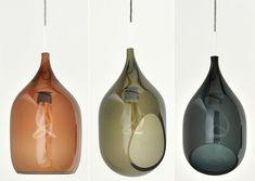 Vessel Series Three glass pendants showcasing the lightbulb's illusory qualities