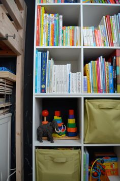 Shared kids room - Bookcase styling by Meg Padgett from Revamp Homegoods.  www.revamphomegoods.com