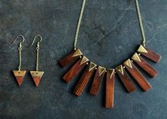 A great trend to follow this summer is wooden jewelry! We have a great assortment of earrings, bracelets and necklaces made of this beautiful natural material. Whether you're trying to achieve the Bohemian, modern, or trendy look, we have some gorgeous pieces to help you! We have a great statement necklace that looks fantastic with our En Crème maxi dress. If you pair it with our hammered disc earrings and our wood bangle with brass inlay, you have a great summer outfit! This look is so easy…