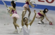 Japan's Mao Asada waves after she performs at the women's free skating at the ISU World Team Trophy  in Tokyo April 13, 2013.  http://uk.eurosport.yahoo.com/photos/figure-skating-slideshow/japans-mao-asada-waves-she-performs-womens-free-photo-124604377.html