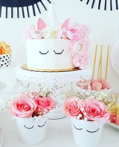 Unicorn cake and floral arrangements from a Sweet Unicorn Birthday Party on Kara's Party Ideas | KarasPartyIdeas.com (6)