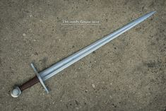 "13thC Templar Sword Overall Length 36.8"" Blade Length 30.1"" Blade Width 2"" Cross guard 6.9"" Grip 4.1"""