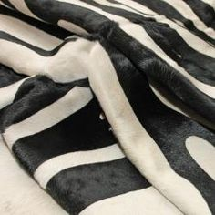 @Overstock - Bring a rustic look into your home with this premium quality Brazilian cowhide rug. Hand-picked in Brazil of soft leather, this area rug will brighten up any room and provide a soft plush texture under foot. http://www.overstock.com/Home-Garden/Hand-picked-Brazilian-Black-White-Zebra-Cowhide-Rug-5-x-7/5500463/product.html?CID=214117 $402.29