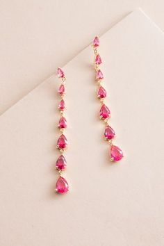 Droplet Wonder Dangle Earrings | Pink $20 // Long gold dangle earrings placed with beautiful pink crystal stones.