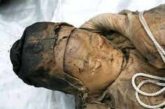 """Photograph from Fame Pictures/Barcroft With eyebrows, hair, and skin still intact after more than 600 years, a remarkably preserved Chinese """"wet mummy"""" remains bundled in her quilt after centuries in a flooded coffin. Removed from her wooden casket on March 1, the body had been found in a tomb accidentally uncovered by roadbuilders near the city of Taizhou."""