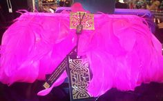 Flutter those feathers girls with this fluorescent pink clutch bag from House of Fraser. Brighten up any LBD!