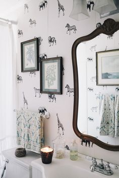 OBSESSED with this washroom wallpaper Read more - http://www.stylemepretty.com/living/2013/09/23/flora-faunas-home-tour/