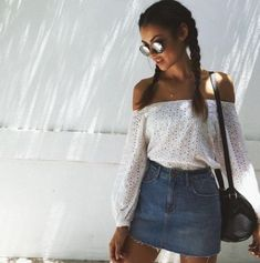 Pretty off the shoulder white lace top with denim mini skirt.