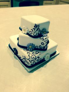 Our miniature wedding cake thanks to ellicakes on etsy! Perfect way to have a keepsake of your cake. She does ornaments but we just wanted a model cake