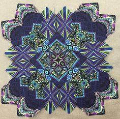 My first all fussy cut block using Paula Nadelstern's fabrics.
