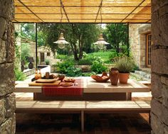 An inviting shaded outdoor dining spot...in France, of course.