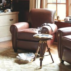A cozy corner sit with a book, like these leather armchairs by Ballard Designs, is the best cure for a long day on your feet.