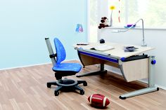 moll Runner ergonomic table in maple finish and Maximo chair with blue upholstery.
