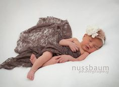 This gorgeous super stretchy lace wrap is easy to use and can be completely swaddled around newborn babies for the perfect first photo! Edges are unfinished. For a great setup you can coordinate these