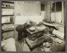 "TENEMENT LIFE at its worst: A tenement kitchen in 1910. Unlike the Tenement Museum's recreations of furnished and fit apartments, which are ""new tenements,"" this kitchen with a coal stove is a demeaning, filthy place."