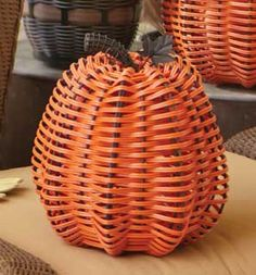 """Longaberger  Small Outdoor Pumpkin-90436  seasonal accent made to withstand cool temperatures and fall weather. Reusable year after year, woven with durable bright orange nylon around a black coated metal frame and stem knob. 10 1/4""""d x 11""""h"""