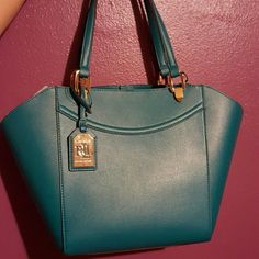 12fc02a5ff Turquoise Ralph Lauren leather tote New with tags. Great for everyday. Fits  the size of a paper folder. The color is amazing. Ralph Lauren Bags Totes