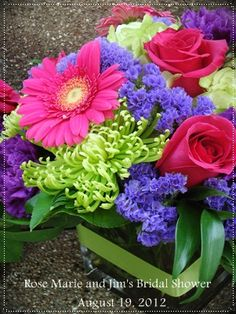 hot pink gerbera daisies, green fjui mums, hot pink roses, statice, moonvista carnations, green hydrangea, ruscus