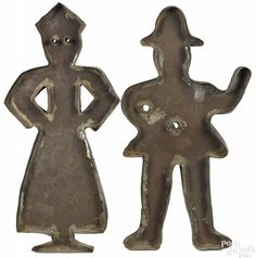 Pair of tinned sheet iron cookie cutters, 19th c., of a man and woman, 14 1/4'' h. and 14 1/2'' h. - Price Estimate: $400 - $800