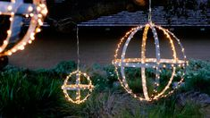 Starlit Globes    Create outdoor chandeliers by wrapping lights around old wine-barrel hoops, then suspending them from the branches ofa large tree. Even easier: Rest one globe each atop two large planters flanking the front door.