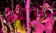 """""""The gulabis (translation: pink gang), whose members say they are a """"gang for justice,"""" started in 2006 as a sisterhood that looked out for victims of domestic abuse. Named after their hot-pink sari uniforms, the gang paid visits to abusive husbands and demanded they stop the beatings. When obstinate men refused to listen, the gulabis would return with large bamboo sticks called laathis and """"persuade"""" them to change their ways."""""""