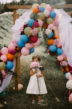 colourful balloon arch | wedding altar | flowers |