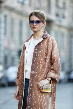 The European Guide To Flawless Style #refinery29  http://www.refinery29.com/milan-fashion-week#slide-64  A classic trench coat in a brazen print (but still in a neutral color!) is so much more interesting but still matches everything....