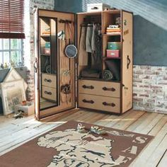 Love this child's wardrobe shaped like a travel trunk! Love the whole line.