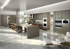 Indirect lighting with drop down ceiling and toe kick cabinets - gray cabinets fotos de cocinas modernas