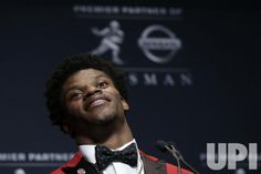 Louisville Cardinals quarterback Lamar Jackson speaks at a press conference at the Marriott Marquis after winning the Heisman Trophy award…