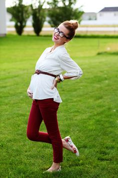 I meannnnn. WHO LOOKS THIS CUTE PREGNANT?!?! Red lips, top knot, glasses, printed blouse, brown belt, crimson curduroys, floral ballet flats, mis-matched bangles. (the daybook).