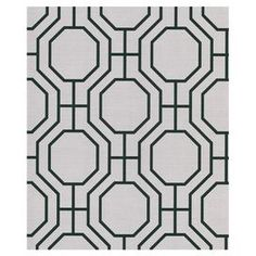 """Pre-pasted wallpaper with an octagon motif.Product: Wallpaper Construction Material: Prepasted paper Color: Black and gray Features: Classic wall covering Octagon design 10.44"""" Design repeat Dimensions: 396"""" x 20.5"""" x 0.25"""""""