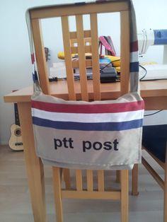 Een messenger bag met postzak stof