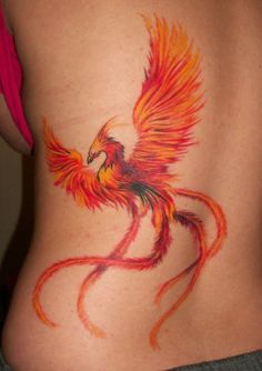 A phoenix rises from the ashes in this fire bird tattoo. The tail feathers are like fiery ribbons that rail behind the mythical bird « « Ratta Tattoo