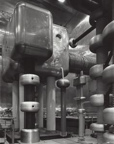 The Cockcroft-Walton accelerator at Japan's High Energy Accelerator Research Organization (KEK) (2008). The Cockcroft-Walton accelerator was introduced in 1932 and was the first apparatus to artificially accelerate atomic particles to high energies, according to Nature. KEK's Cockcroft-Walton device, still in use, accelerates to 800,000 volts, according to Janet Conrad, a physics professor at MIT. Fermilab also has a Cockcroft-Walton accelerator, now out of operation. Photo by Stanley…