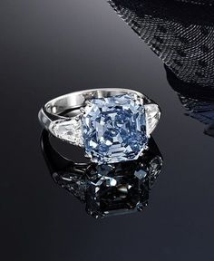 A Highly Important and Very Rare Fancy Vivid Blue Diamond and Diamond Ring'