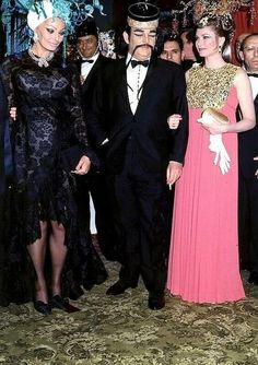 """Sophia Loren, Prince Rainier, and Princess Grace , in Dior,at the """"Bal des Coiffes"""" at the Monte-Carlo Casino, 1969.The gown appears pink in this photo but,in person,it is orange/tangerine-- truly is a gorgeous creation.It is on display in Montreal as it was at the Grimaldi Forum, in Monaco    .photocredit gracefilm"""